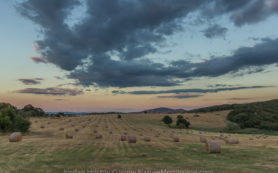 hay fields at sunset